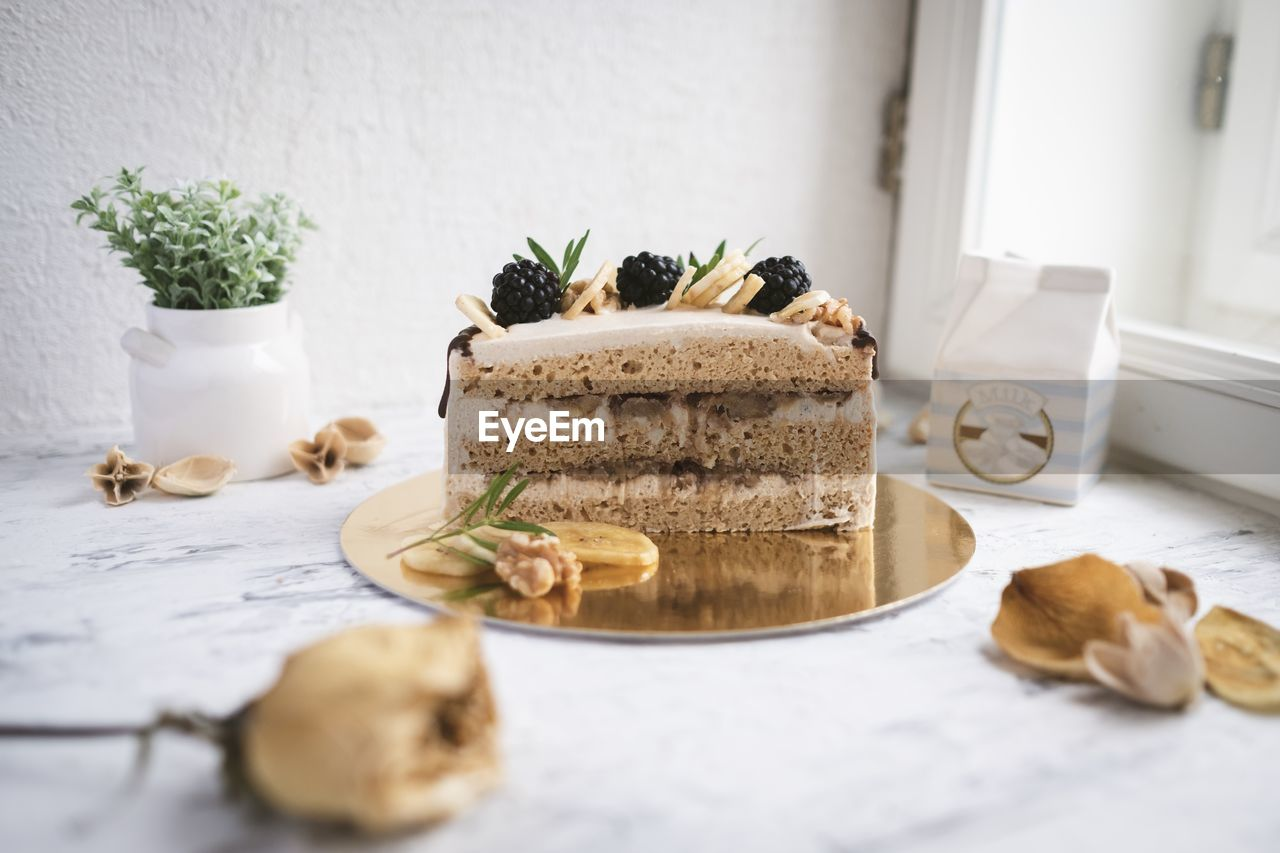 food, table, indoors, food and drink, freshness, still life, plant, no people, indulgence, sweet food, close-up, selective focus, herb, nature, potted plant, baked, cake, ready-to-eat, plate, healthy eating, temptation