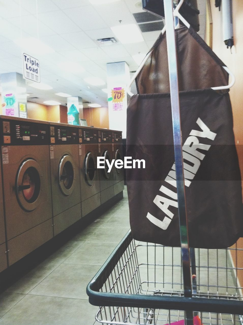 Text of bag by dryers in laundromat