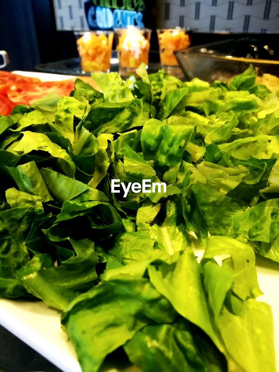 food and drink, food, freshness, healthy eating, vegetable, wellbeing, green color, close-up, indoors, no people, green, lettuce, still life, salad, raw food, organic, leaf vegetable, selective focus, plant part, leaf, vegetarian food, herb, chopped, tray