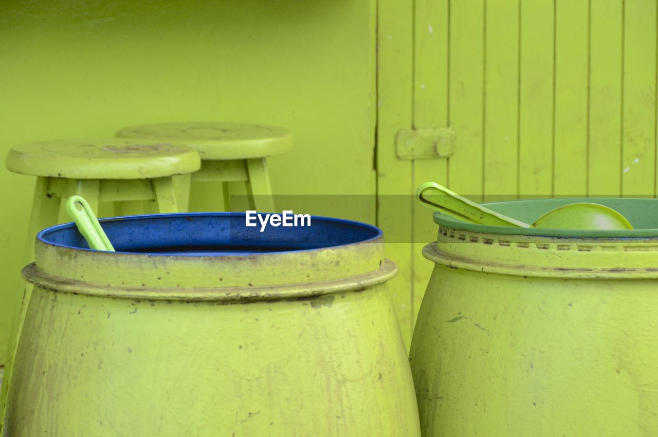 Green Barrels Against Wall