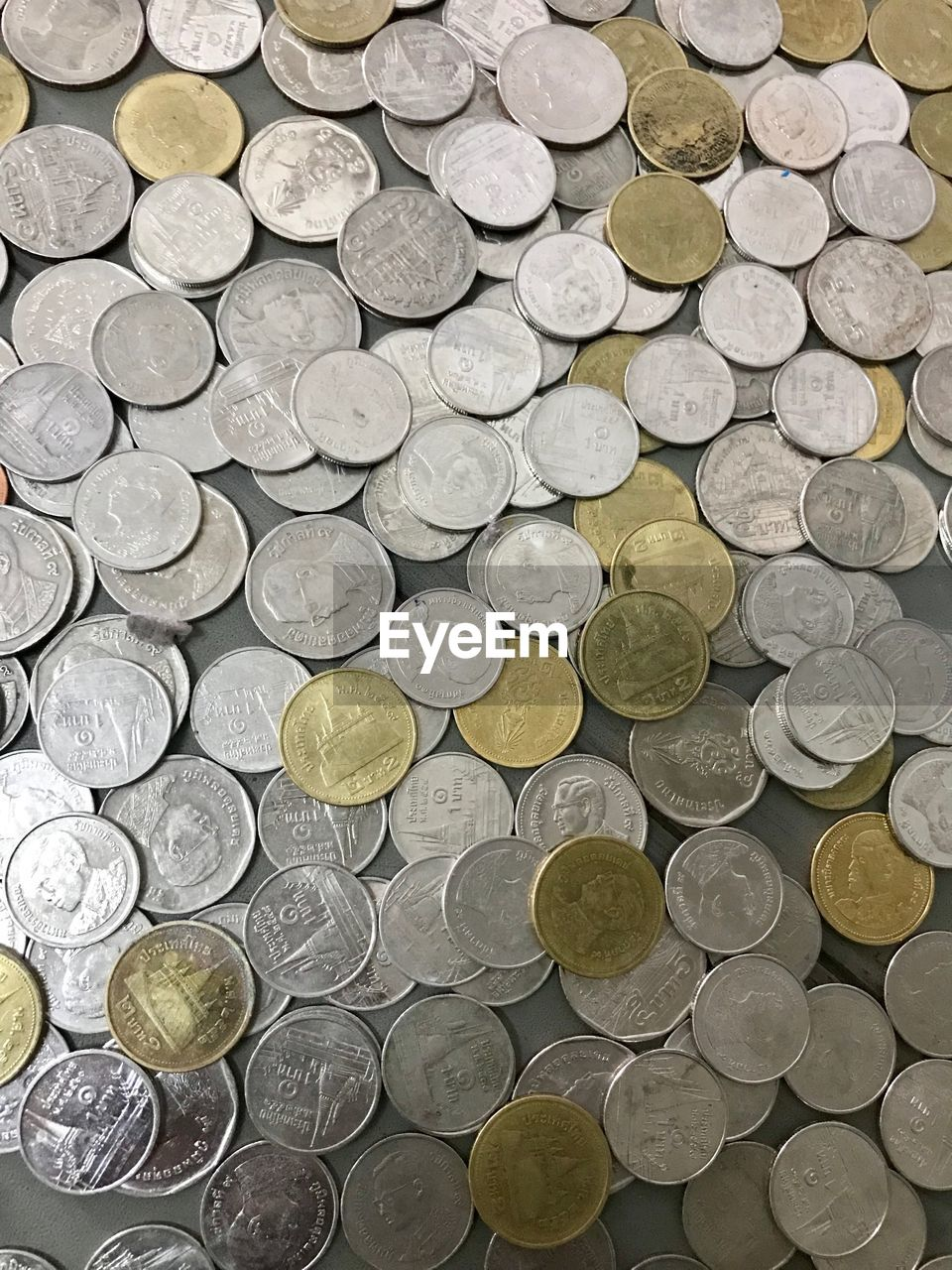 finance, coin, currency, large group of objects, wealth, still life, abundance, no people, business, indoors, full frame, directly above, high angle view, backgrounds, shape, metal, savings, circle, geometric shape, pattern, economy