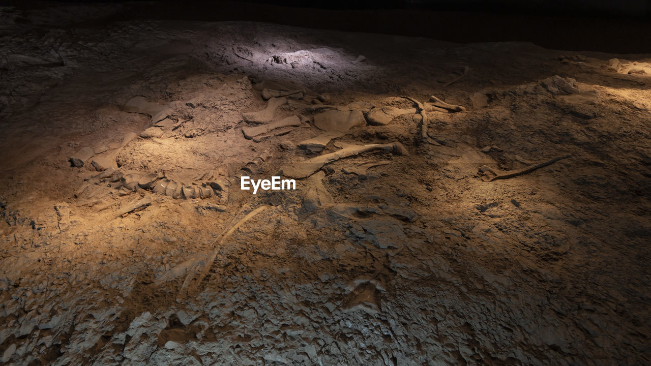 HIGH ANGLE VIEW OF TEXT WRITTEN ON ROCKS