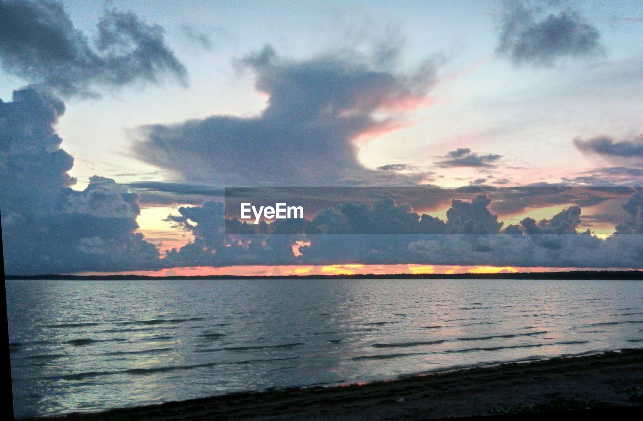 sea, sunset, sky, beauty in nature, scenics, nature, water, tranquility, tranquil scene, no people, outdoors, silhouette, horizon over water, day