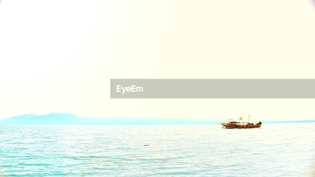sea, water, nautical vessel, waterfront, transportation, copy space, outdoors, scenics, nature, beauty in nature, horizon over water, no people, day, tranquility, clear sky, sky, sailing