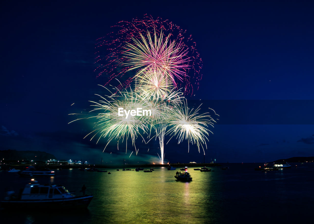 illuminated, firework, night, water, celebration, motion, firework display, arts culture and entertainment, sky, event, exploding, nautical vessel, long exposure, nature, transportation, glowing, mode of transportation, light, firework - man made object, outdoors, sparks