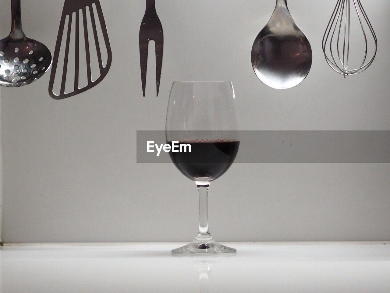 Wineglass with kitchen utensils