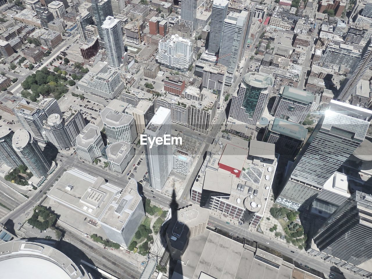 Aerial view of cityscape with cn tower shadow