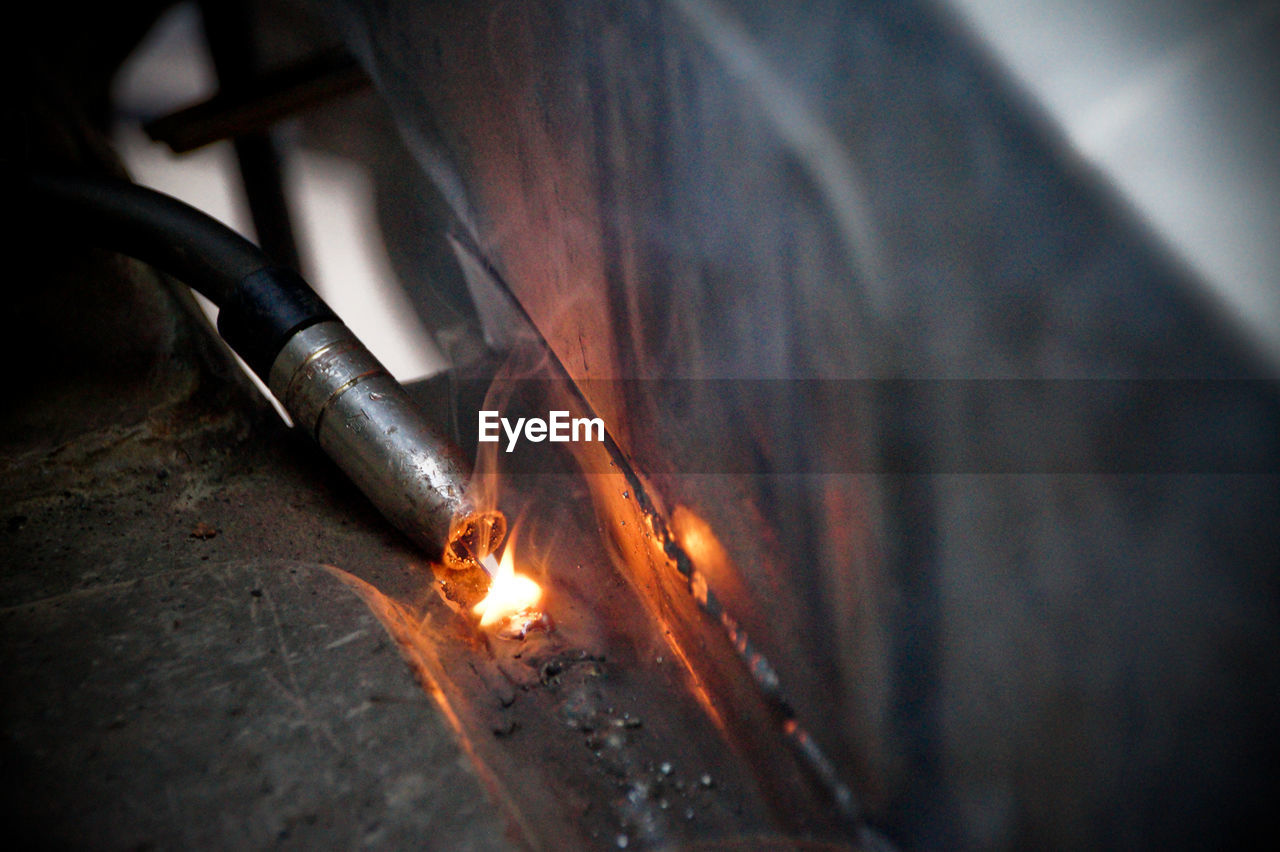 Close-Up Of Welding Machine In Factory