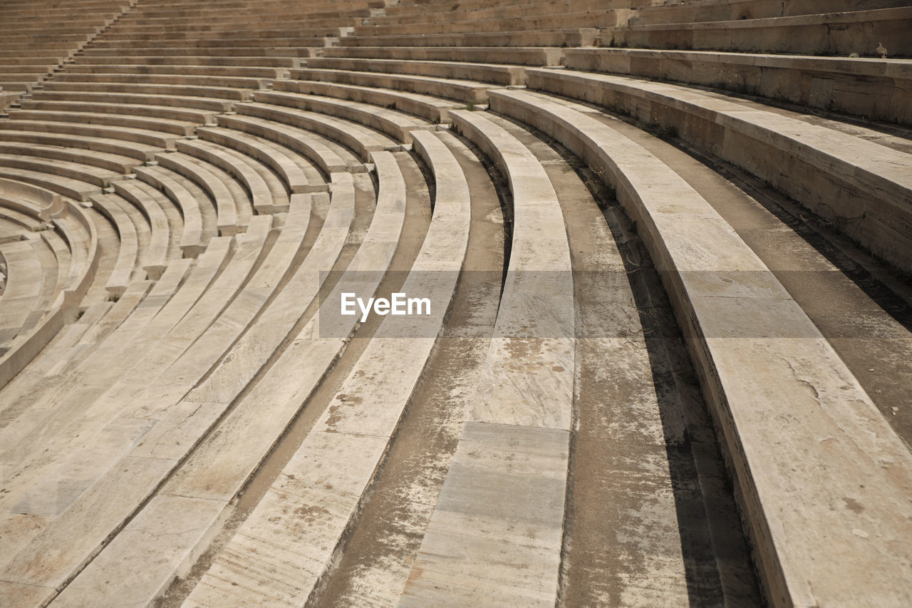 architecture, no people, in a row, day, history, pattern, curve, built structure, the past, empty, absence, ancient, arch, nature, concrete, amphitheater, sport, outdoors, travel destinations, high angle view