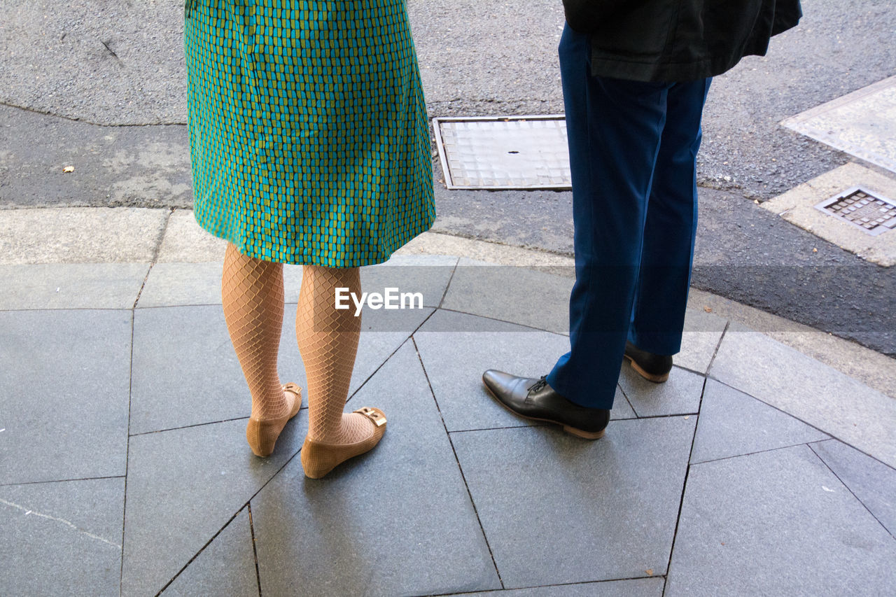 Low Section Of Couple Standing On Sidewalk