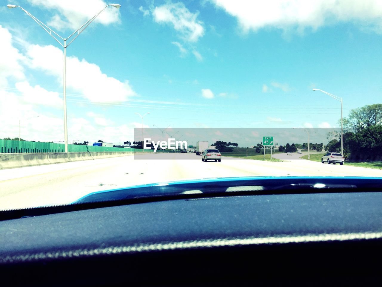 car, transportation, car interior, windshield, road, land vehicle, day, sky, mode of transport, car point of view, no people, outdoors, tree, nature