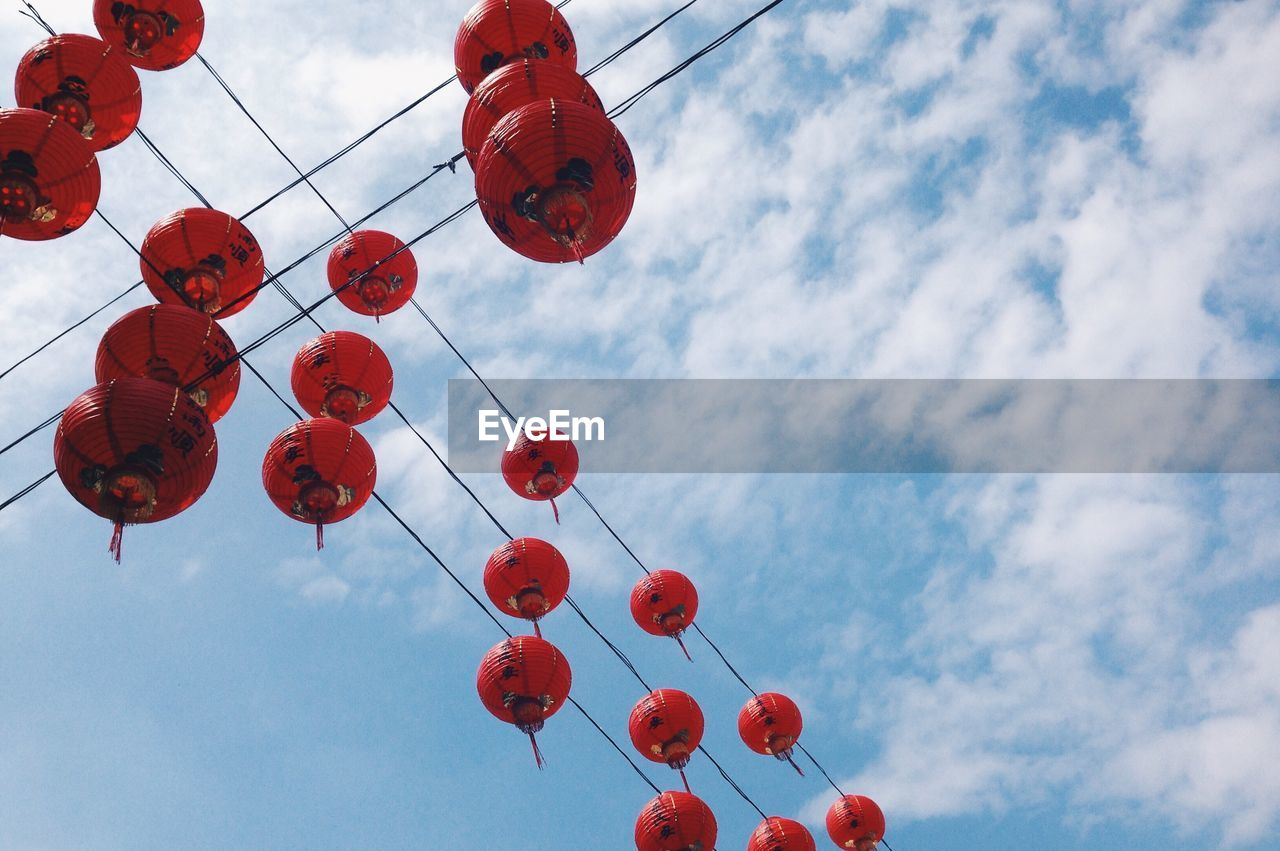 sky, low angle view, cloud - sky, red, chinese lantern, lantern, nature, hanging, decoration, lighting equipment, no people, celebration, day, chinese new year, in a row, repetition, outdoors, chinese lantern festival, festival