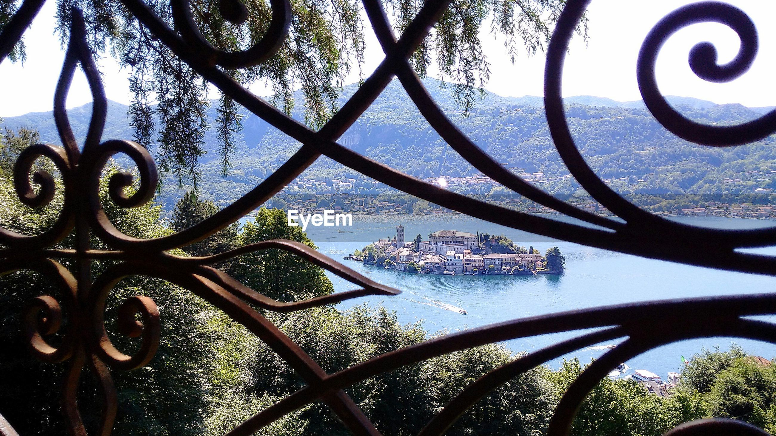 Isola san giulio seen through window of sacro monte di orta