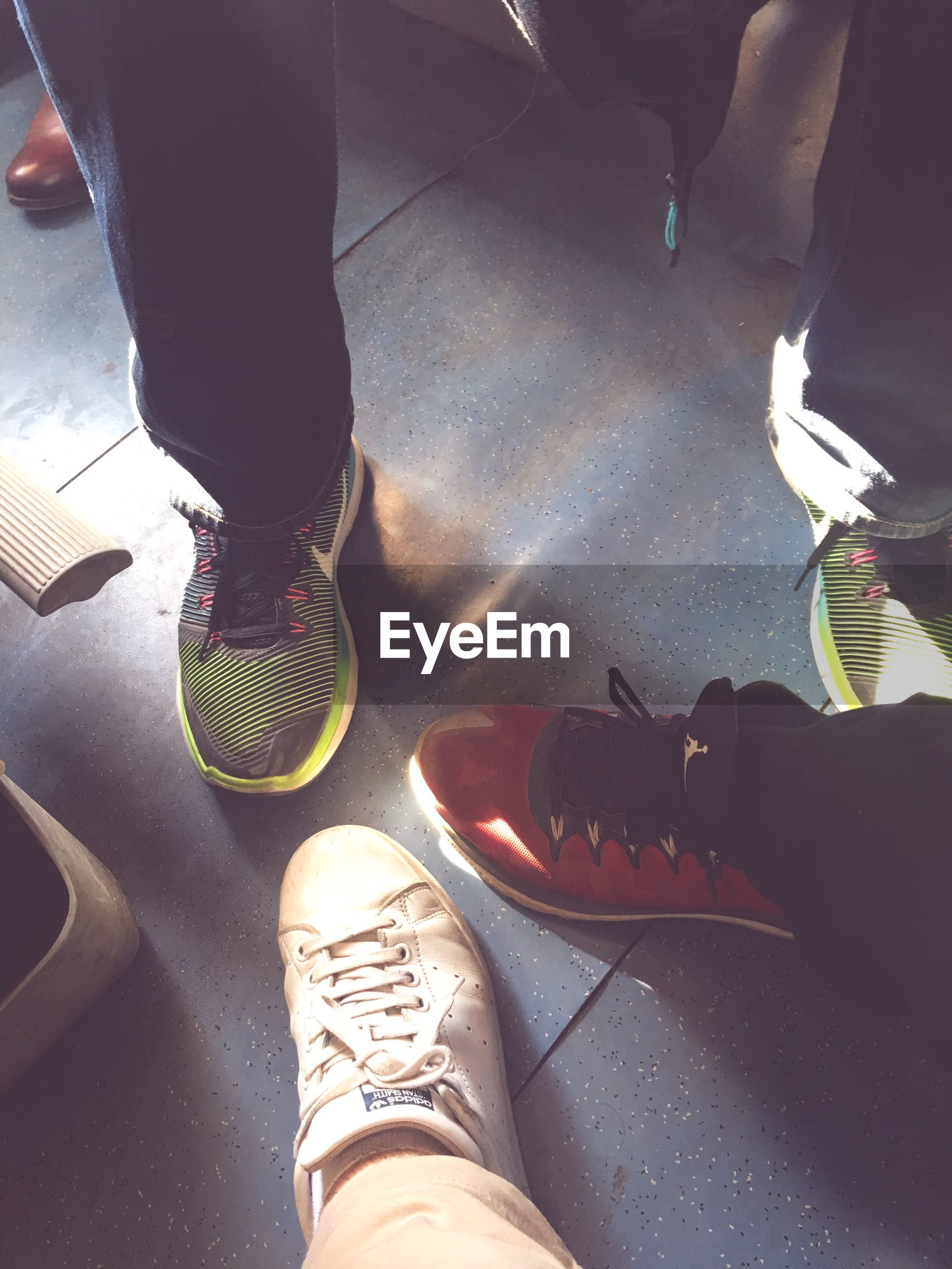 low section, shoe, human leg, human body part, one person, sports shoe, real people, leisure activity, adults only, sock, close-up, standing, men, people, sport, adult, indoors, one man only, day, only men, canvas shoe, ice skate