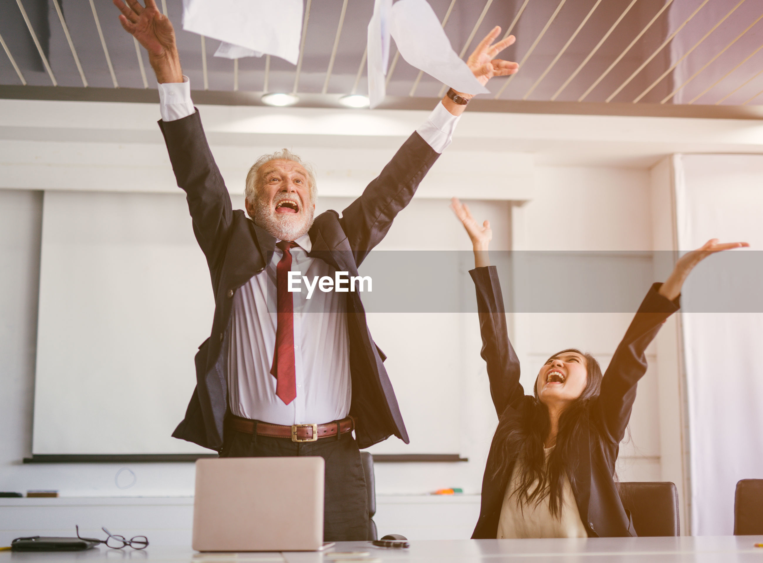 Happy business people at desk in office