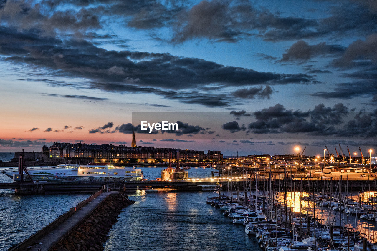 sunset, sky, water, illuminated, cloud - sky, dusk, sea, no people, nautical vessel, outdoors, nature, built structure, scenics, beauty in nature, harbor, architecture, building exterior, city, night, cityscape