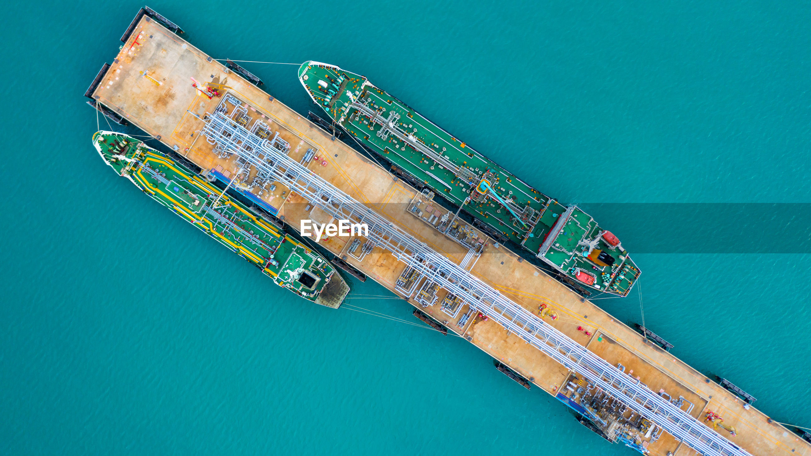 Aerial view of ship by pier over sea
