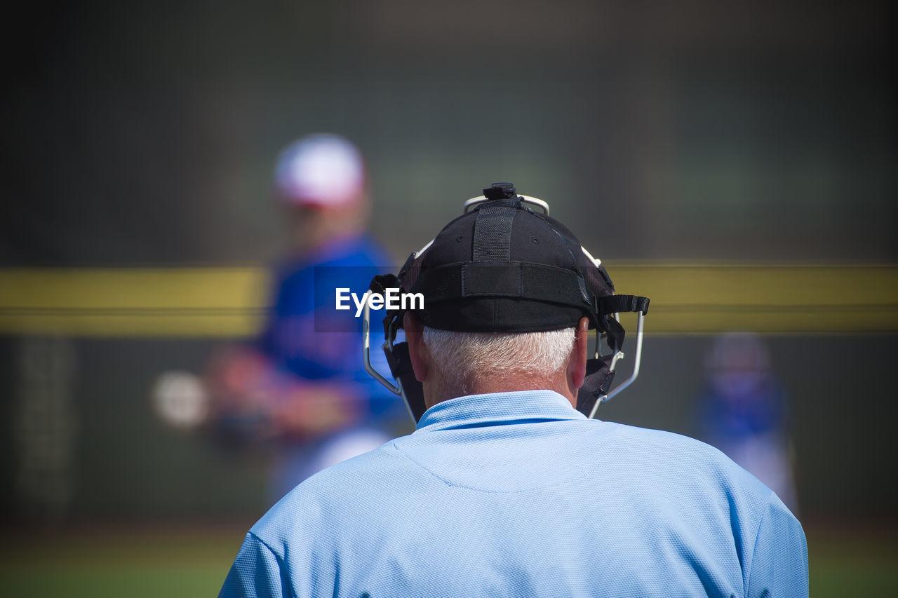 Rear View Of Referee On Baseball Field