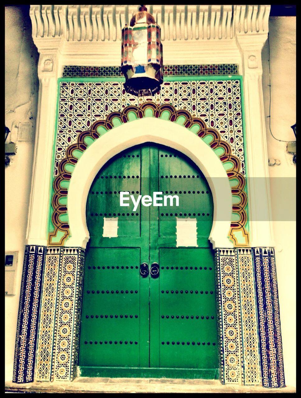 Green Closed Door Of Ancient Mosque