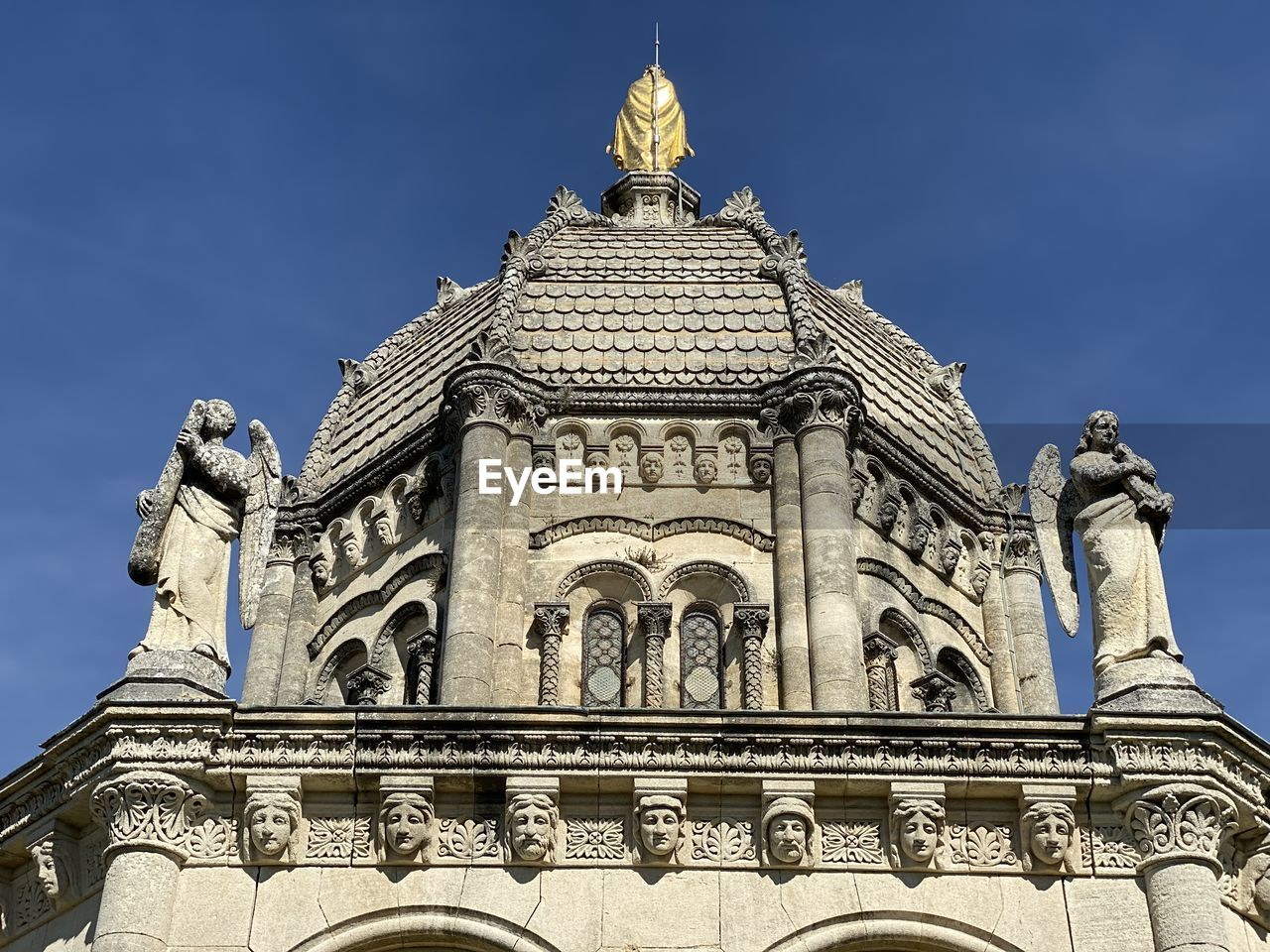 architecture, built structure, building exterior, low angle view, sky, sculpture, representation, art and craft, travel destinations, human representation, statue, nature, no people, city, building, history, male likeness, the past, tourism, travel, outdoors, architectural column, ornate