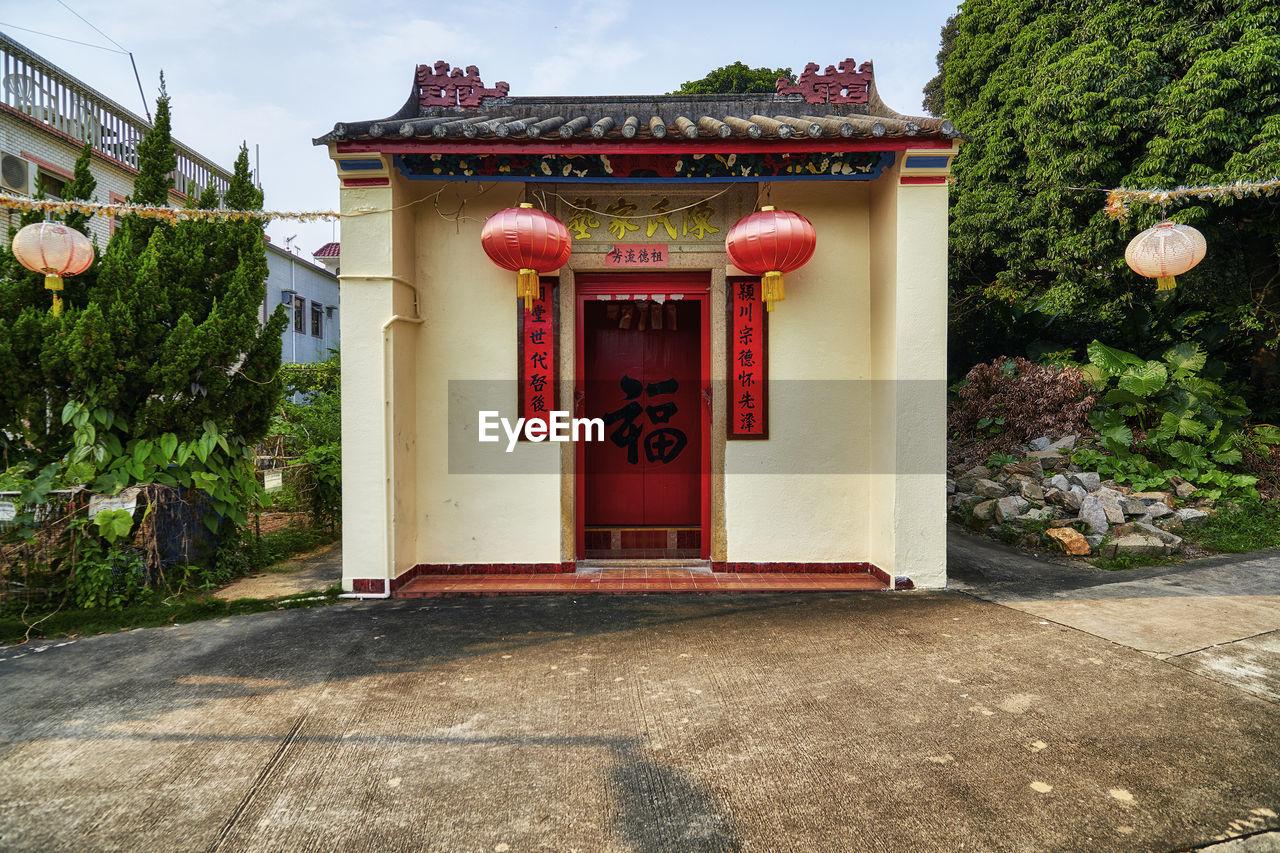 EXTERIOR OF BUILDING WITH RED DOOR
