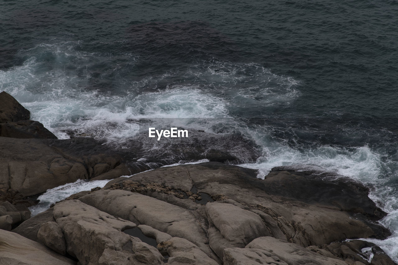 rock, sea, rock - object, solid, water, motion, nature, beauty in nature, rock formation, no people, scenics - nature, aquatic sport, land, beach, high angle view, day, sport, tranquility, outdoors, power in nature, flowing water, flowing