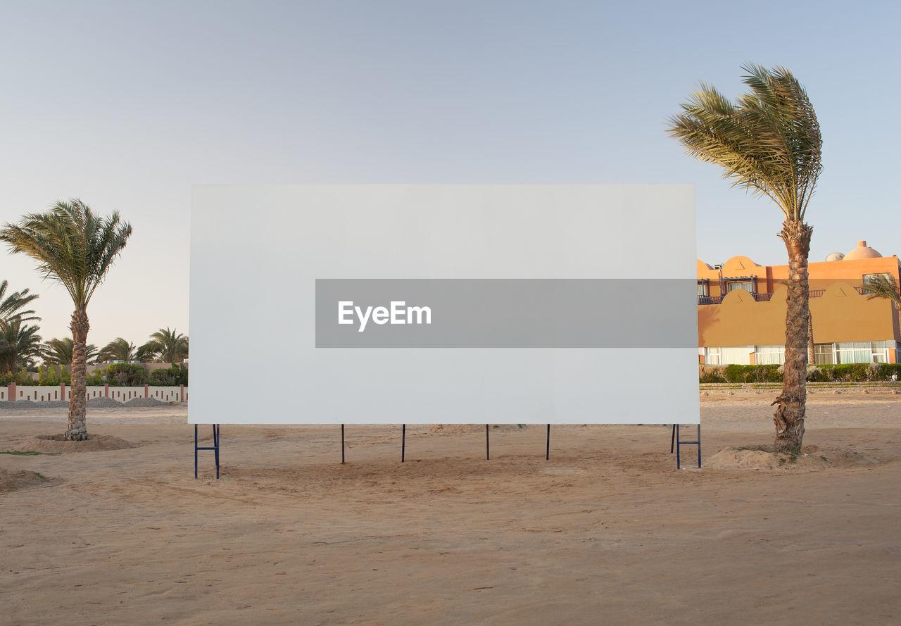 Blank Billboard At Beach Against Sky