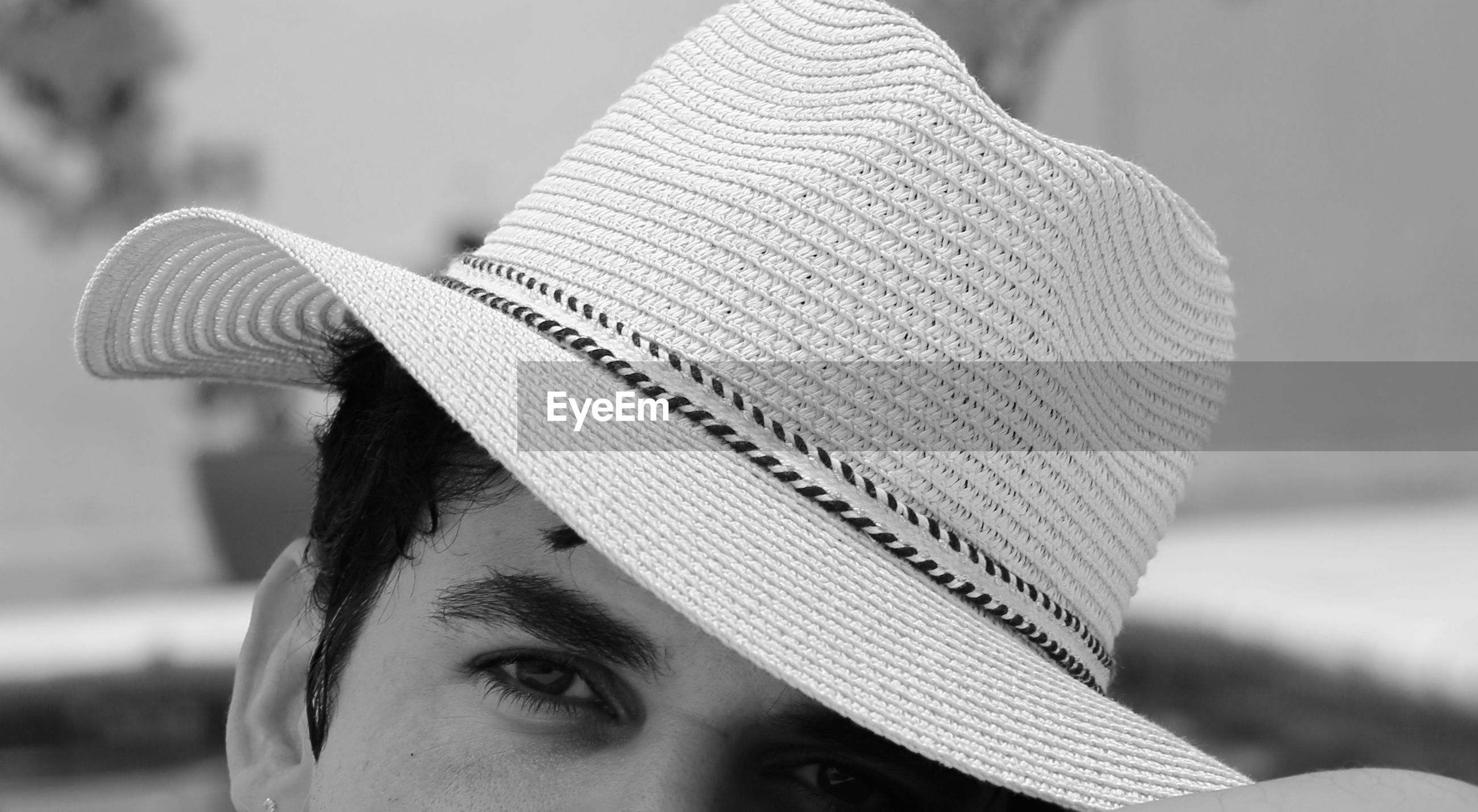 Close-up portrait of mid adult man wearing hat outdoors