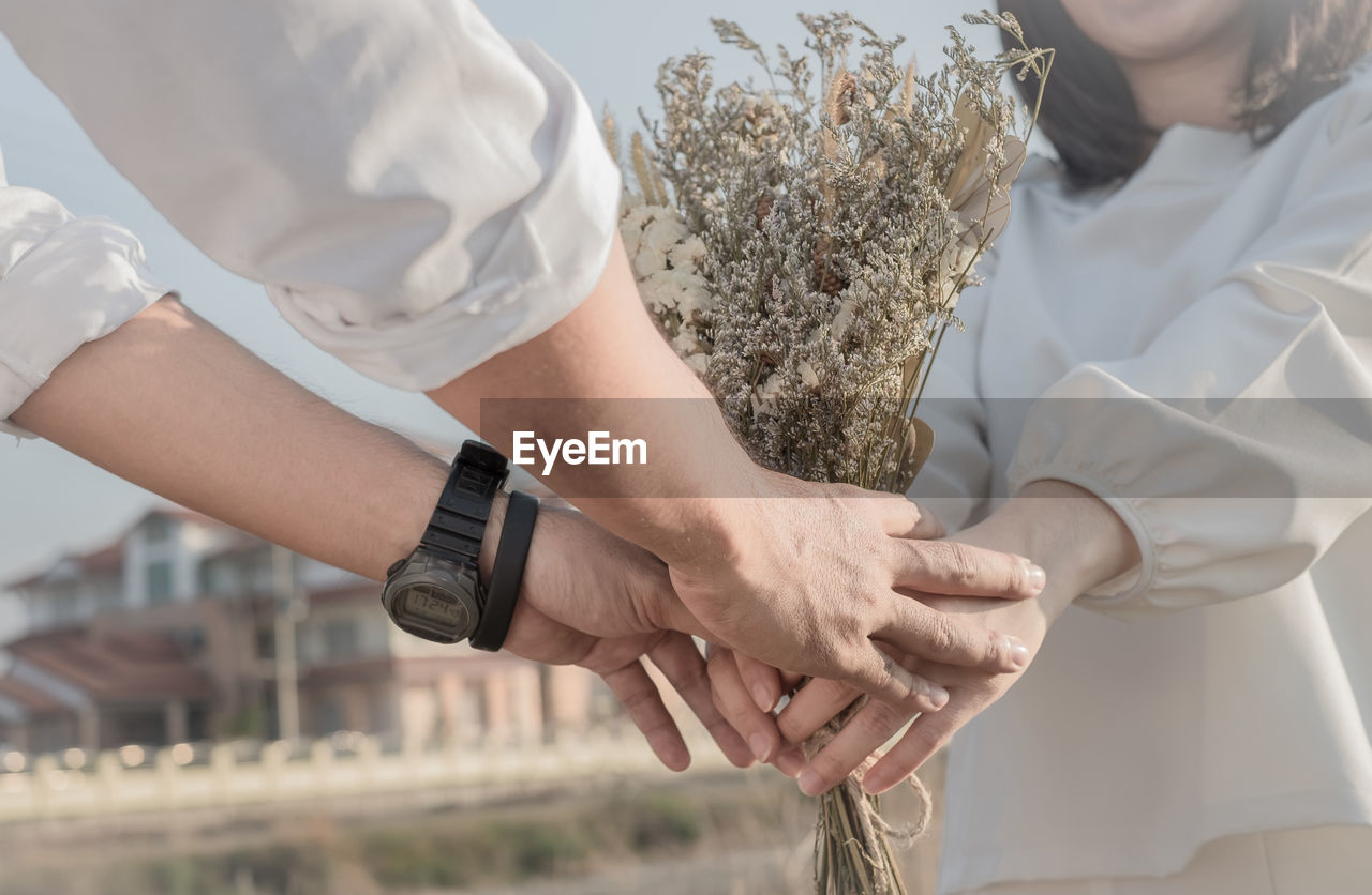 two people, midsection, men, human hand, real people, wedding, togetherness, close-up, women, day, human body part, indoors, wristwatch, bridegroom, groom, bride, adult, people