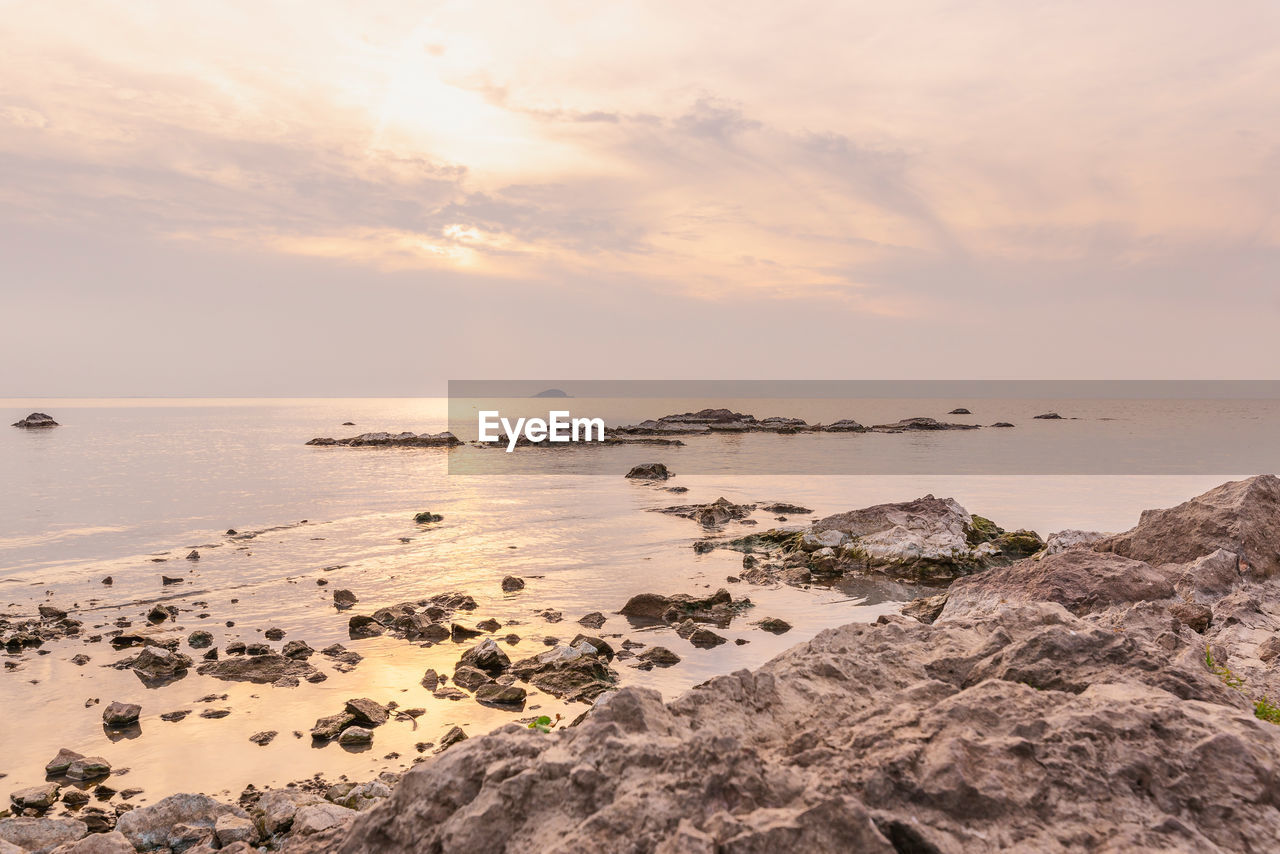 sky, water, sea, scenics - nature, beauty in nature, sunset, tranquil scene, tranquility, horizon over water, cloud - sky, horizon, rock, solid, land, rock - object, beach, idyllic, no people, nature, outdoors, rocky coastline