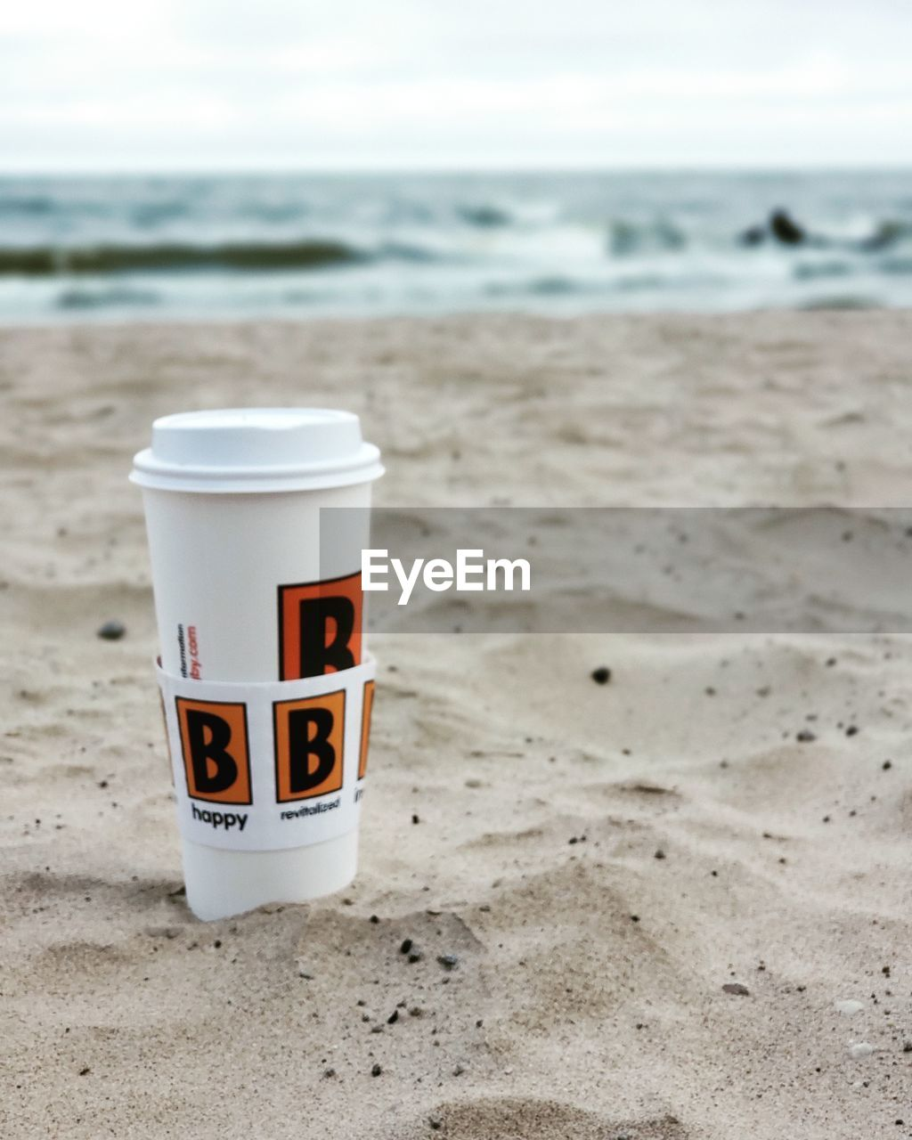 land, beach, sand, sea, water, focus on foreground, cup, horizon, nature, no people, horizon over water, sky, drink, beauty in nature, day, mug, scenics - nature, outdoors, disposable