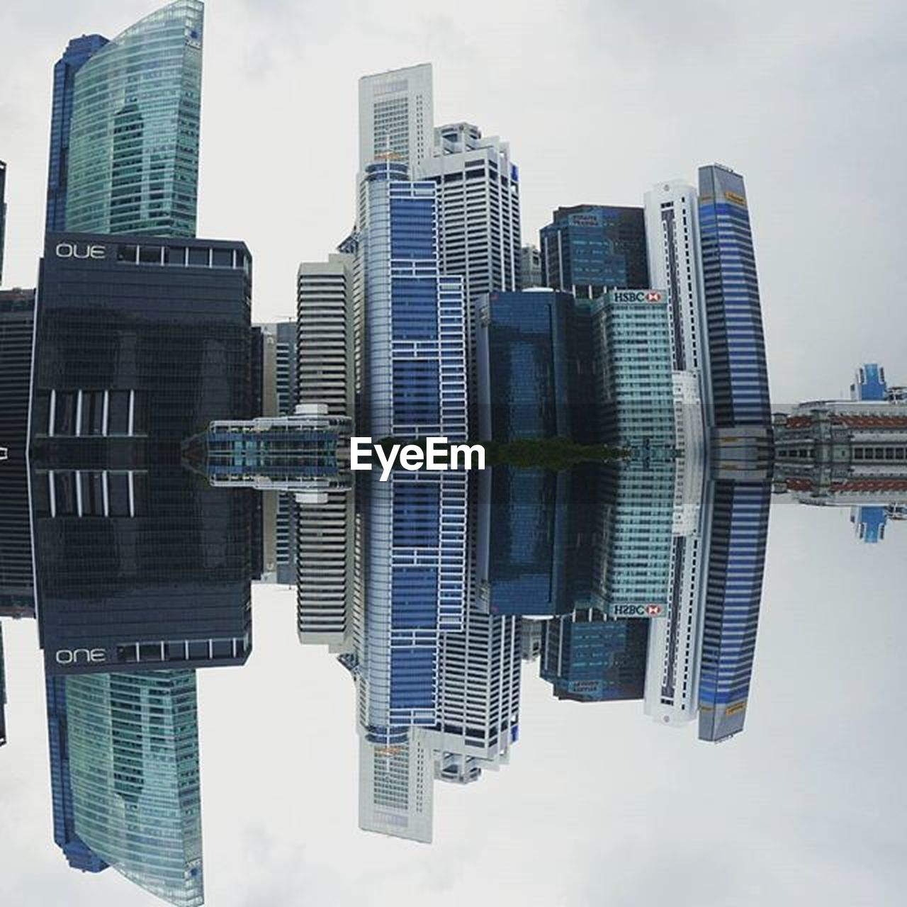 skyscraper, building exterior, architecture, tall - high, tower, built structure, city, cityscape, modern, sky, financial district, urban skyline, downtown district, reflection, water, travel destinations, outdoors, no people, tall, cloud - sky, day