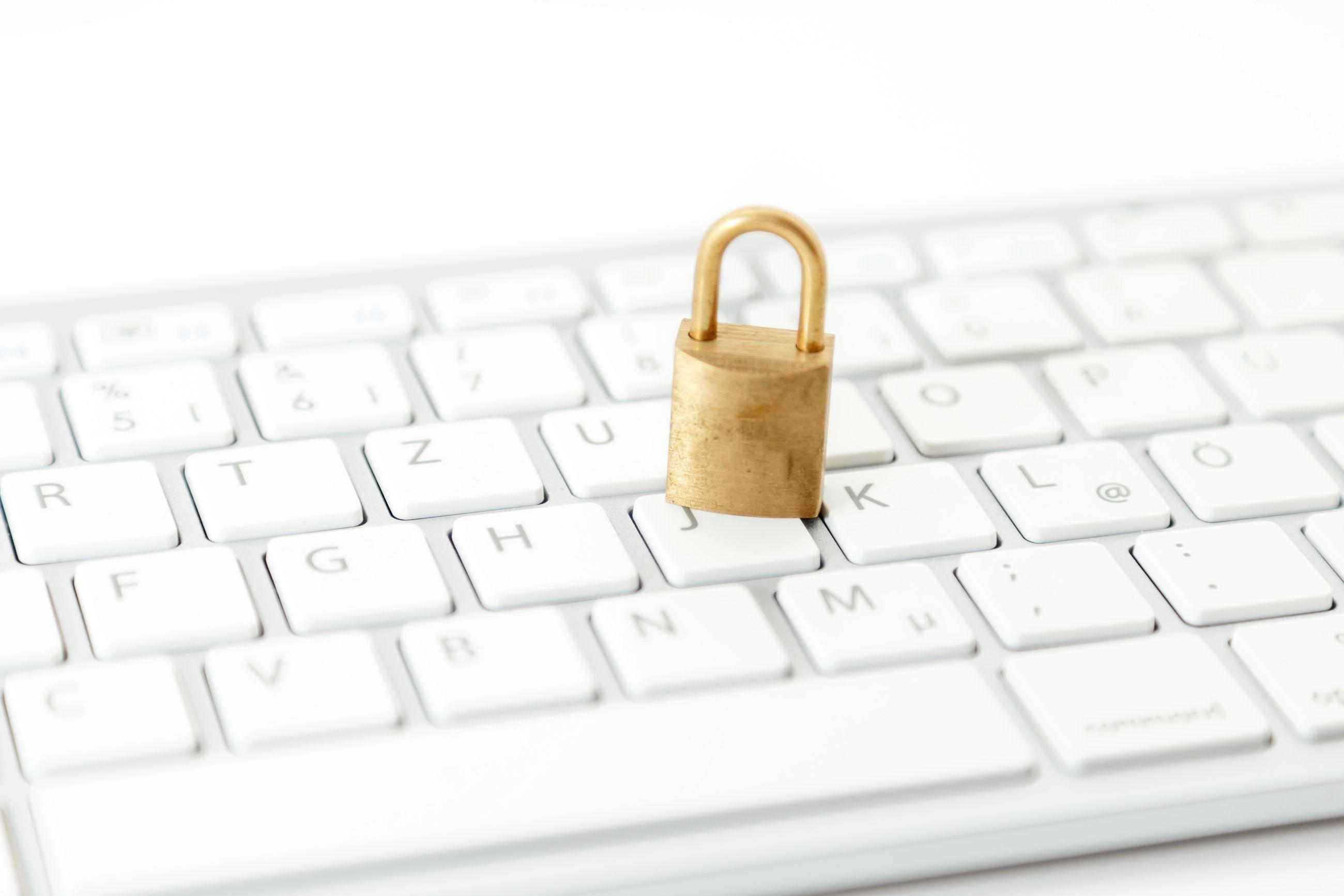 Close-up of padlock on computer keyboard