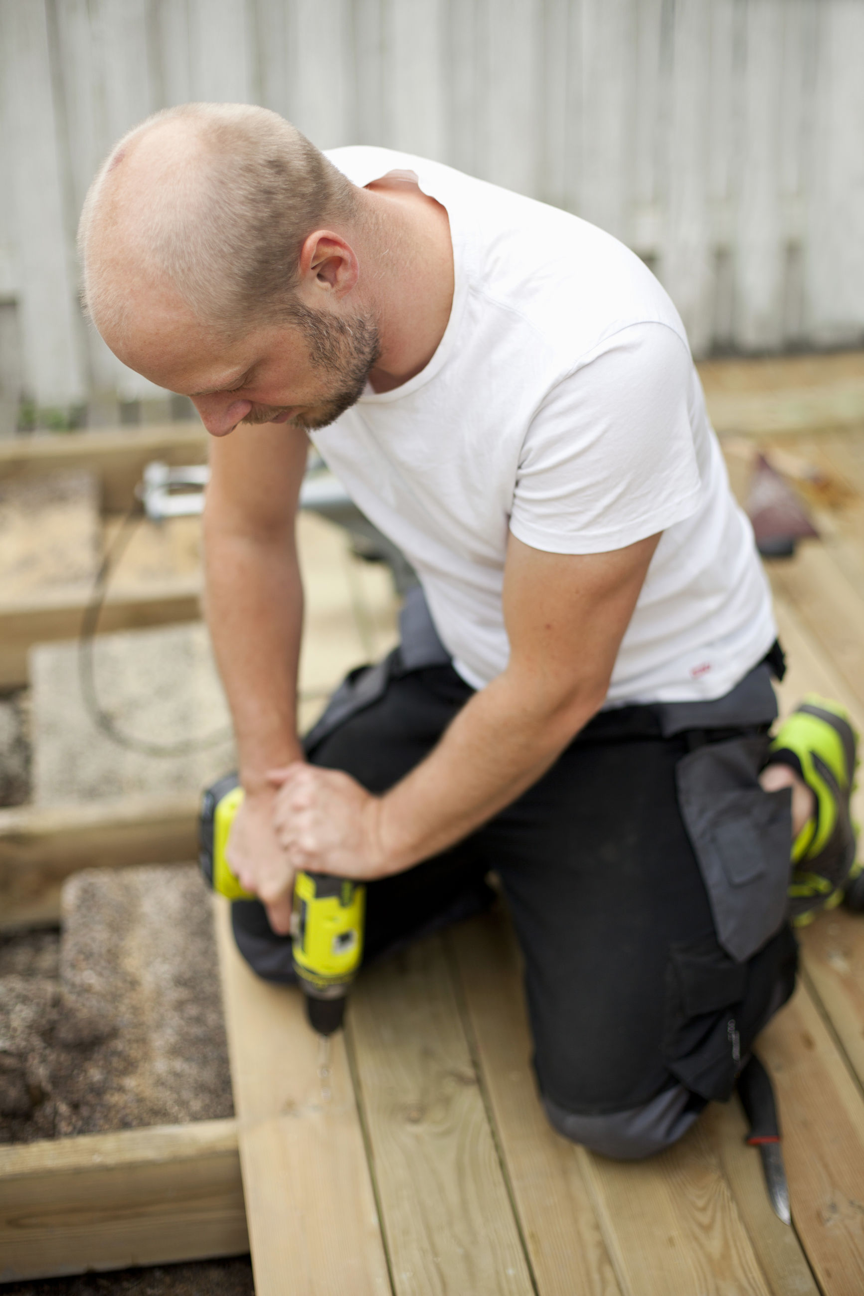 FULL LENGTH OF MAN WORKING WITH WOODEN POST AT HOME