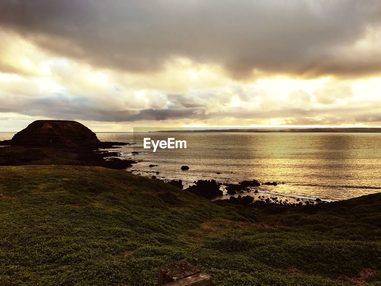 beauty in nature, nature, scenics, sea, tranquility, tranquil scene, cloud - sky, water, sky, horizon over water, grass, no people, outdoors, sunset, landscape, beach, day