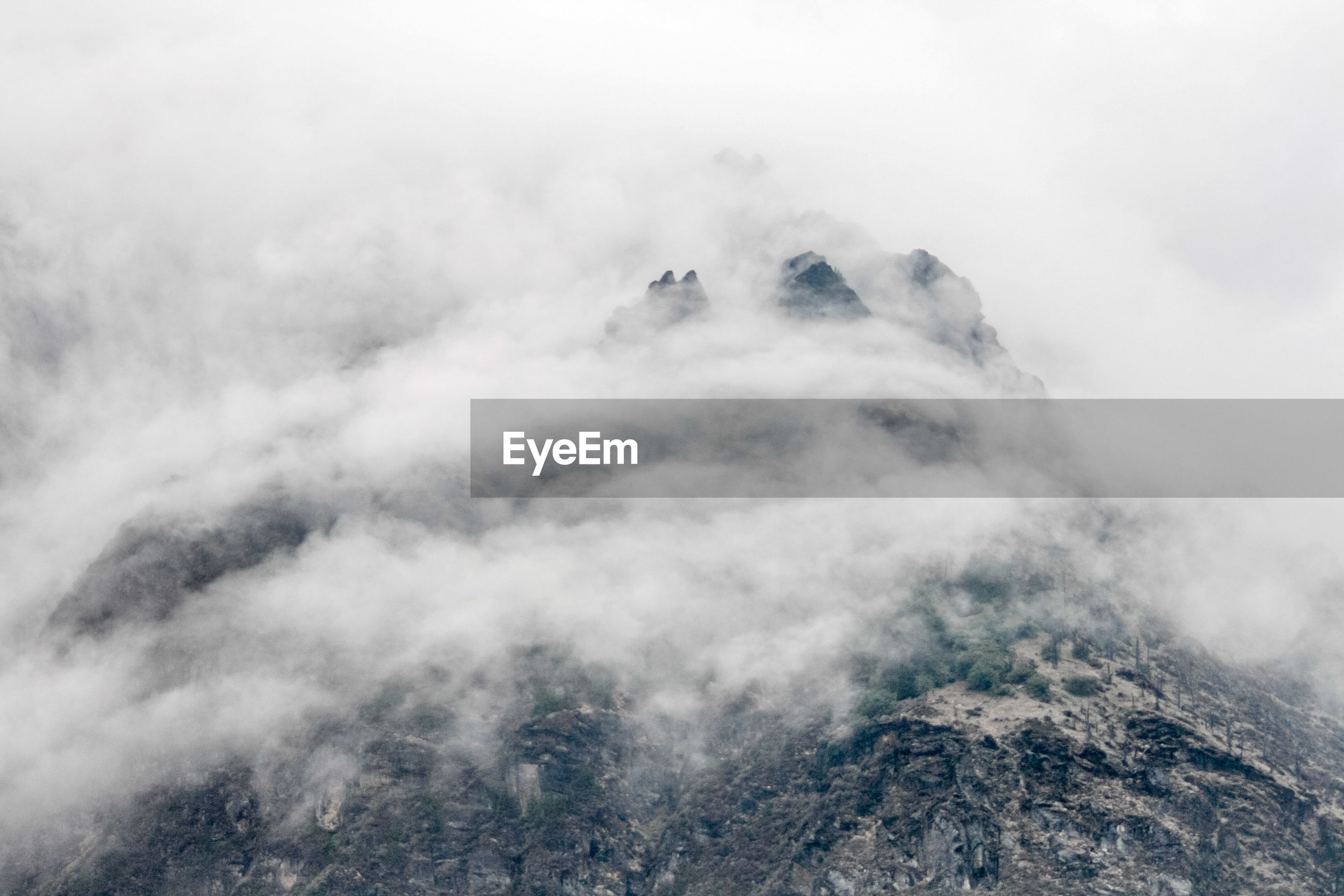 Mountain against sky during foggy weather