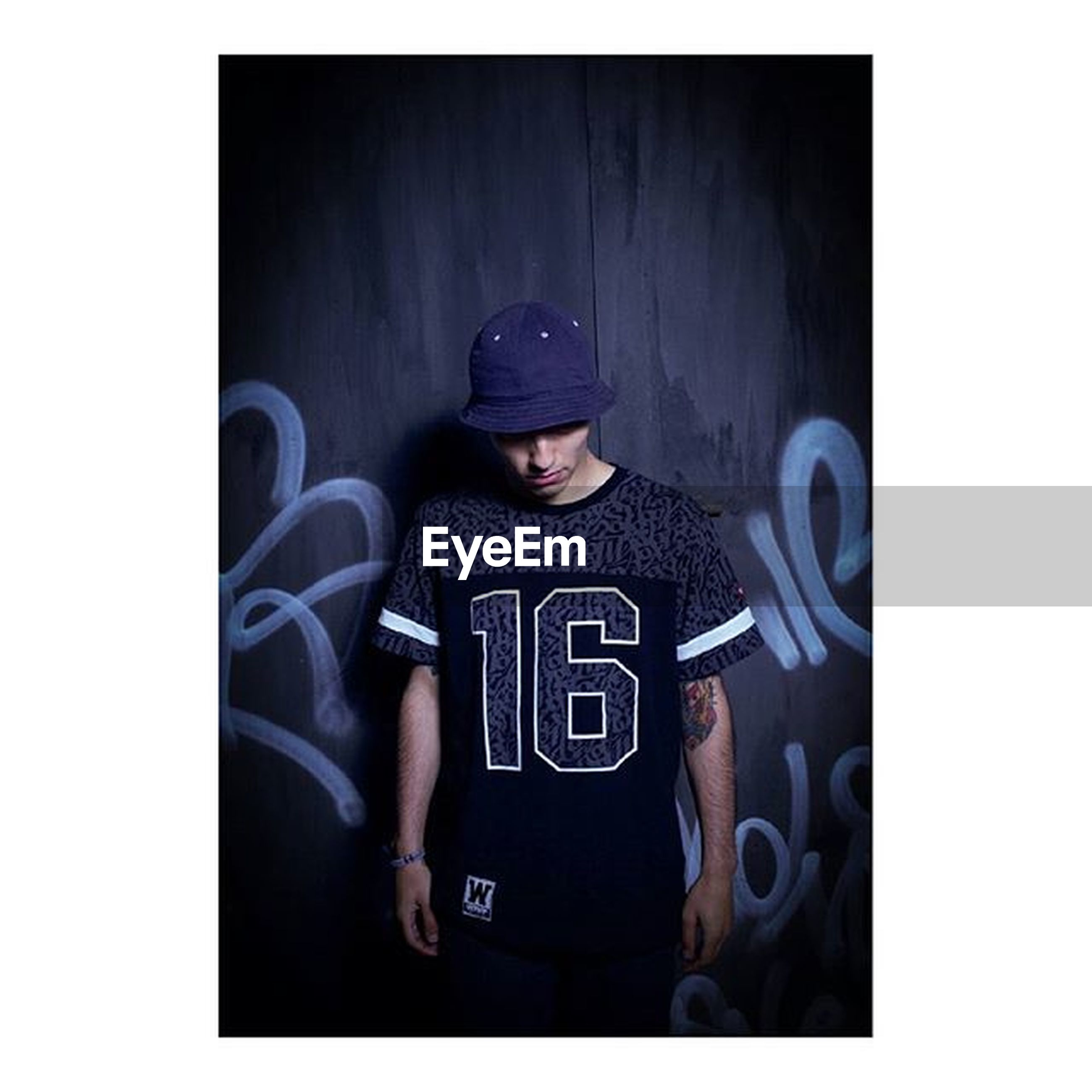 transfer print, lifestyles, auto post production filter, leisure activity, young adult, casual clothing, sitting, person, front view, transportation, photography themes, indoors, wireless technology, young men, men, photographing, full length, technology