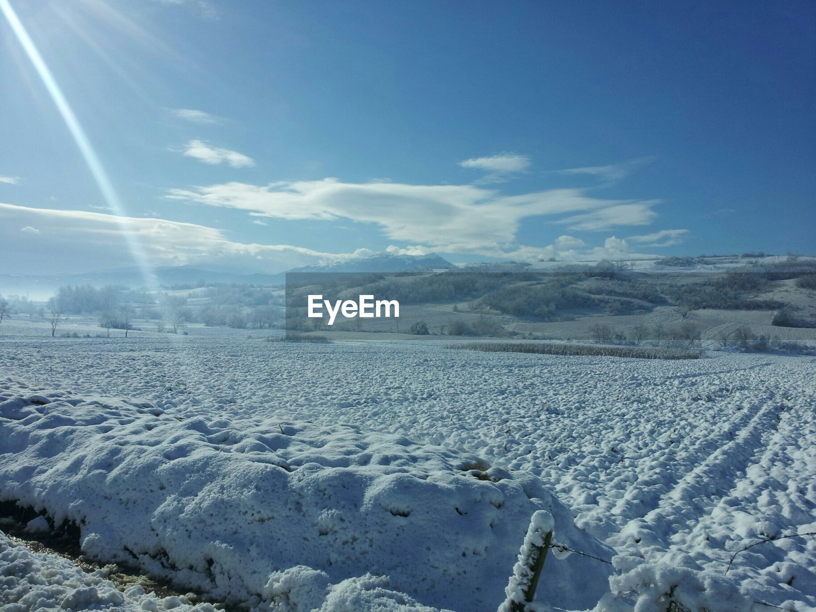 snow, winter, cold temperature, landscape, tranquil scene, season, tranquility, scenics, beauty in nature, nature, sky, weather, mountain, sunlight, covering, sun, blue, field, snowcapped mountain, sunbeam