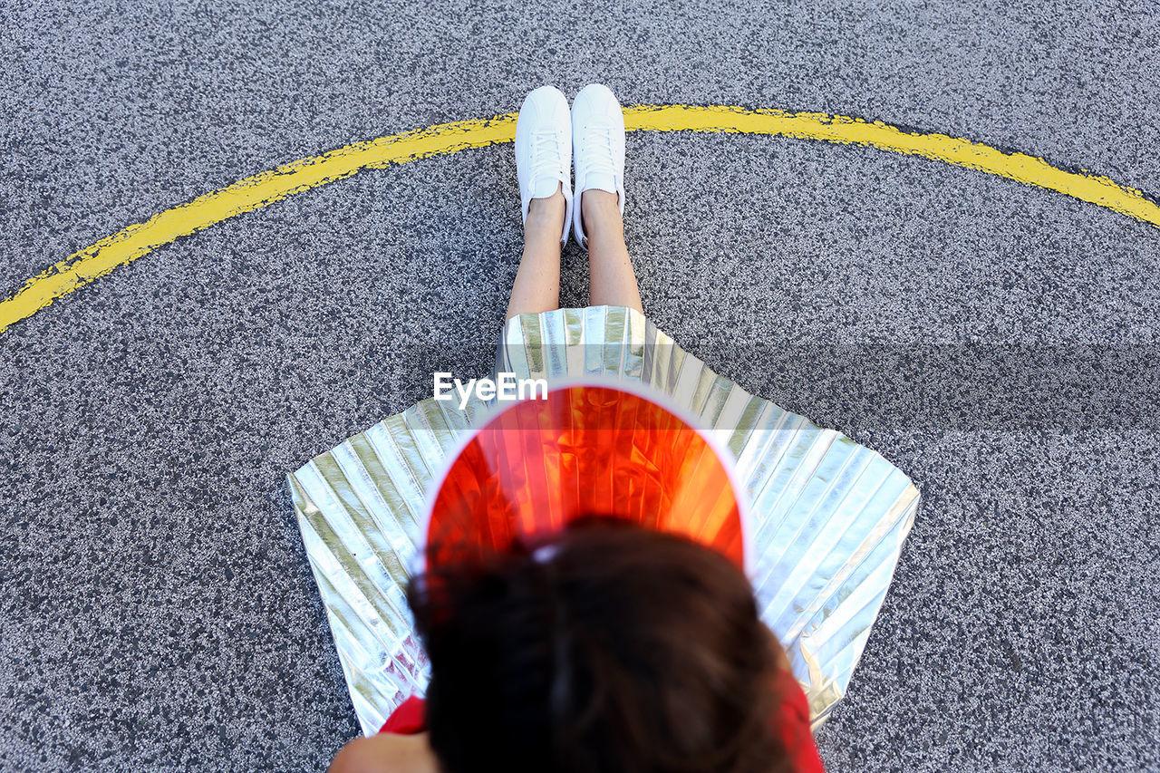 Girl Sitting On Playground