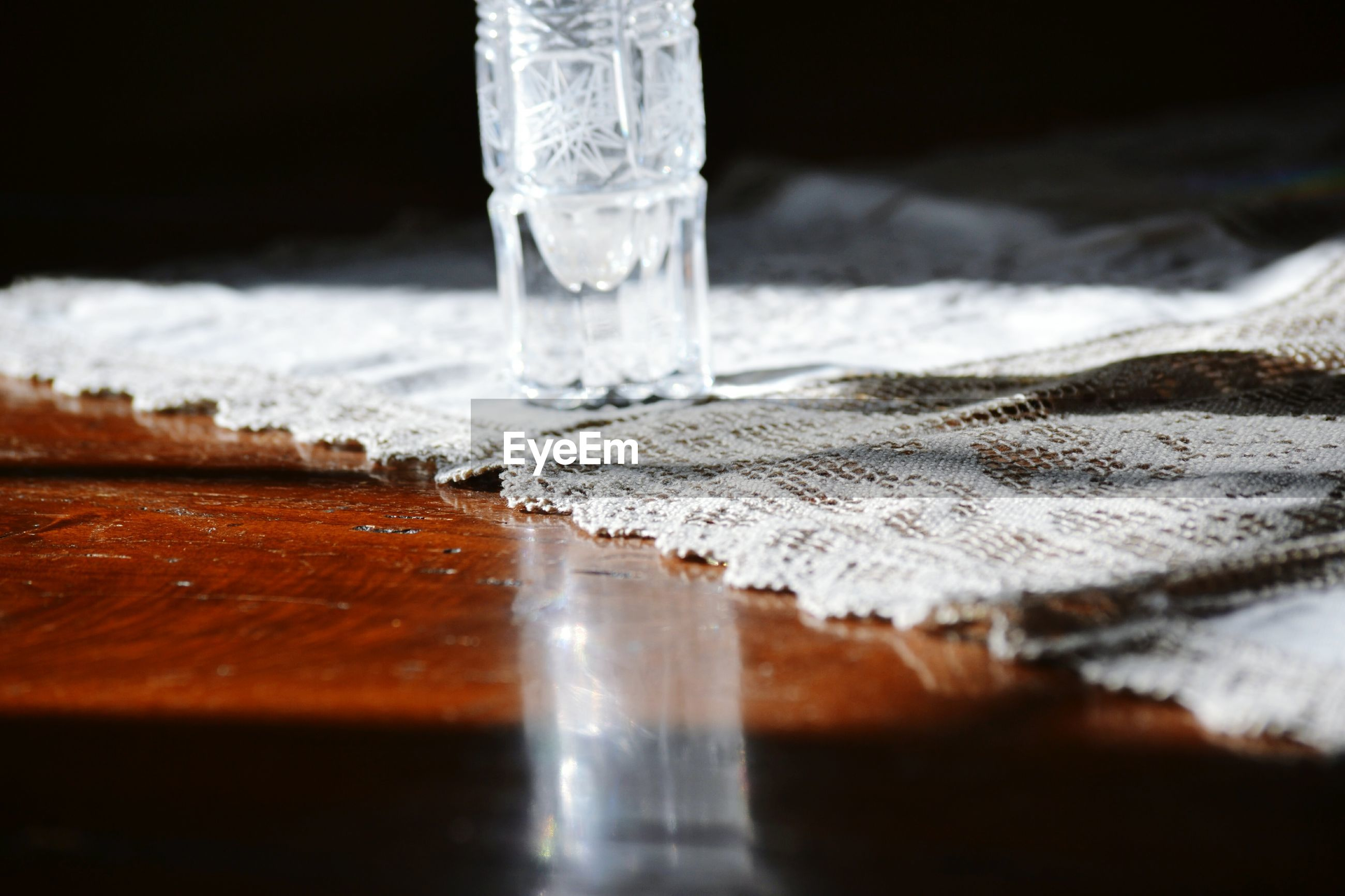 Close-up of crystal vase on table