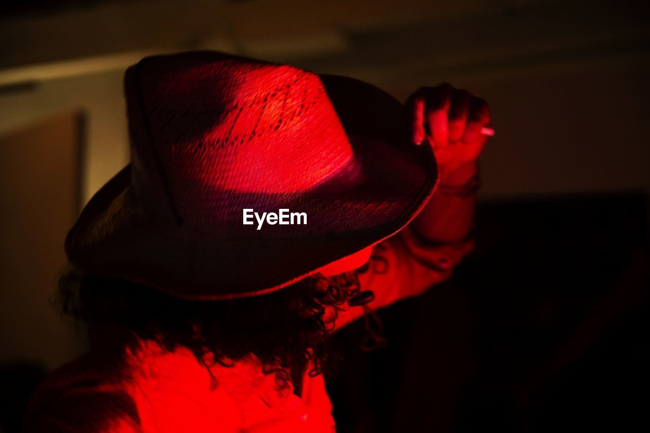 red, hat, one person, real people, indoors, headshot, focus on foreground, clothing, lifestyles, portrait, leisure activity, women, adult, close-up, rear view, costume, arts culture and entertainment, fashion, unrecognizable person, hairstyle
