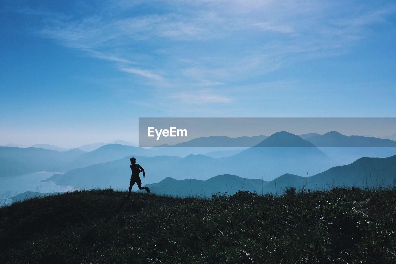 Silhouette Man On Mountain Against Sky