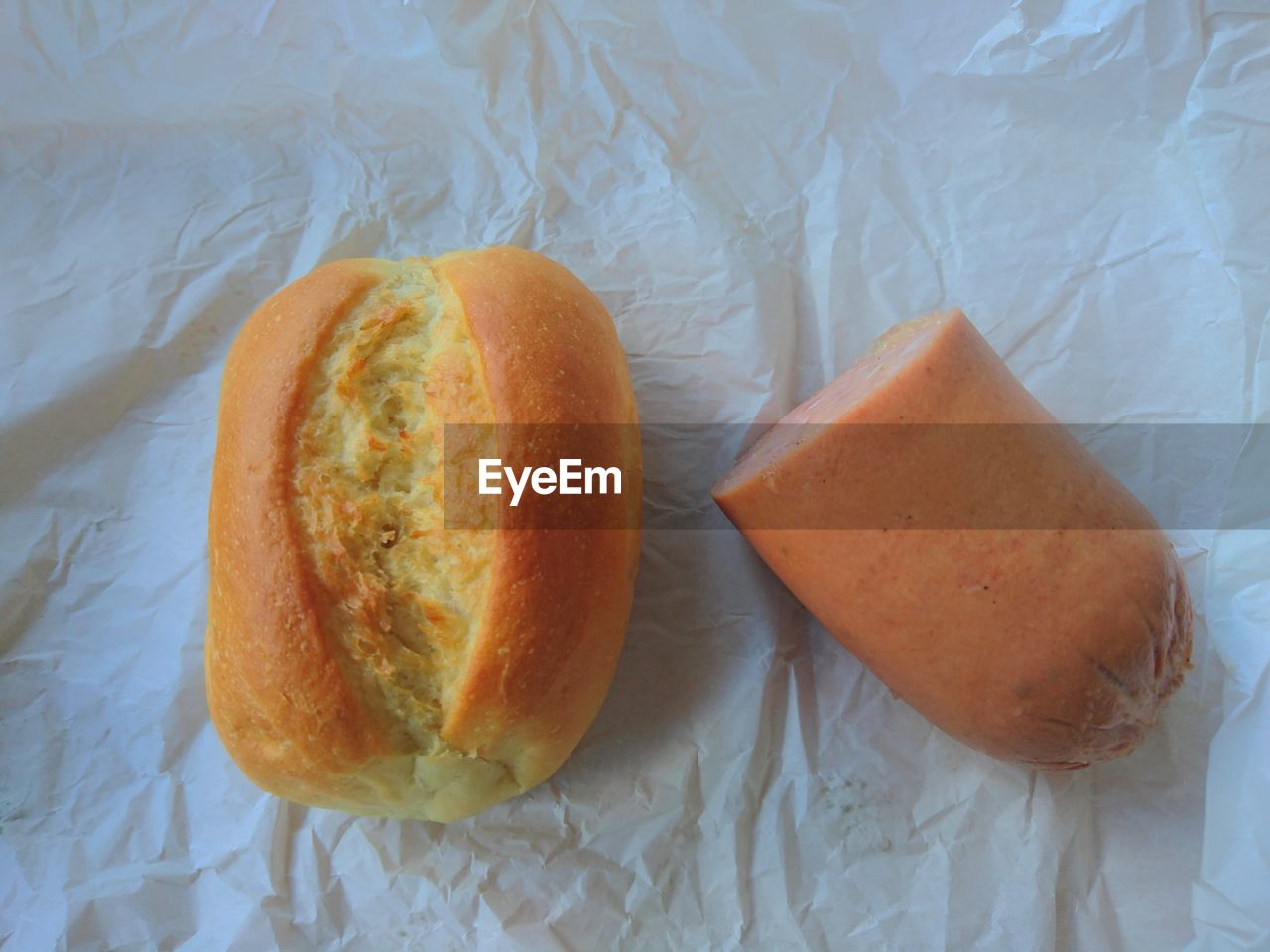 food, food and drink, bread, baked, indoors, freshness, ready-to-eat, no people, slice, indulgence, healthy eating, bun, sweet food, close-up, wax paper, day