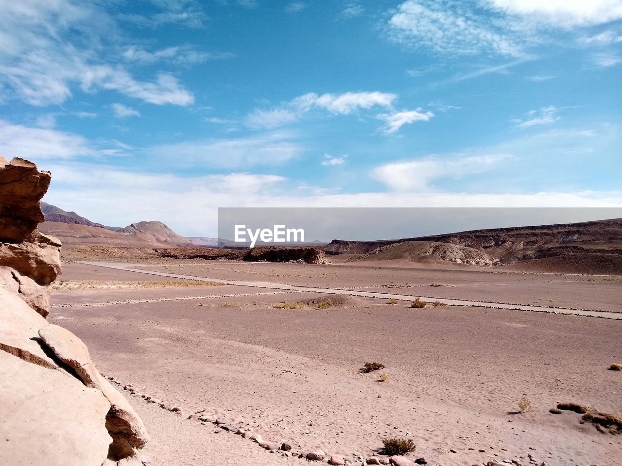 sky, scenics - nature, environment, tranquil scene, landscape, tranquility, beauty in nature, non-urban scene, cloud - sky, desert, climate, land, day, nature, arid climate, remote, mountain, no people, rock formation, sunlight, outdoors, salt flat