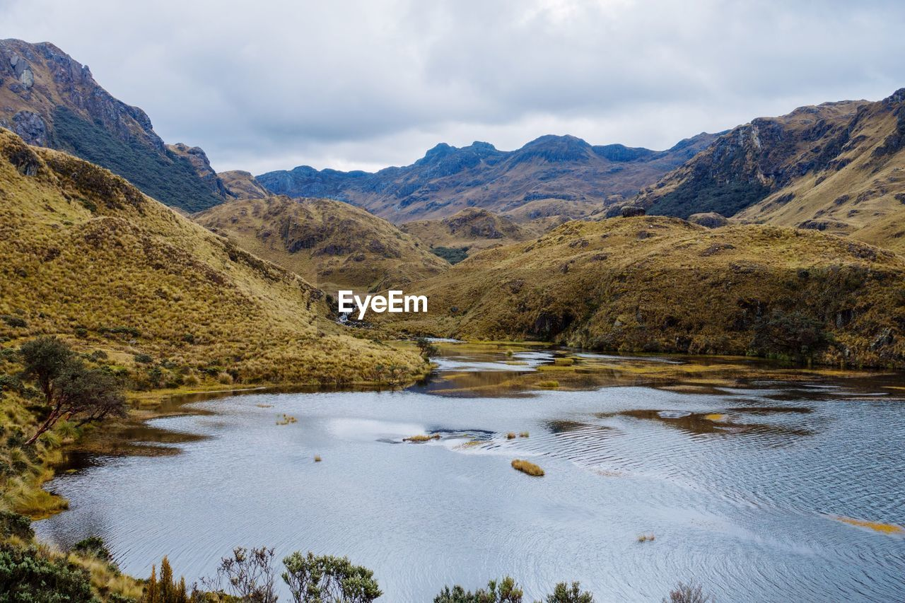 water, mountain, sky, scenics - nature, beauty in nature, cloud - sky, tranquil scene, tranquility, nature, lake, mountain range, non-urban scene, day, no people, landscape, environment, idyllic, plant, outdoors