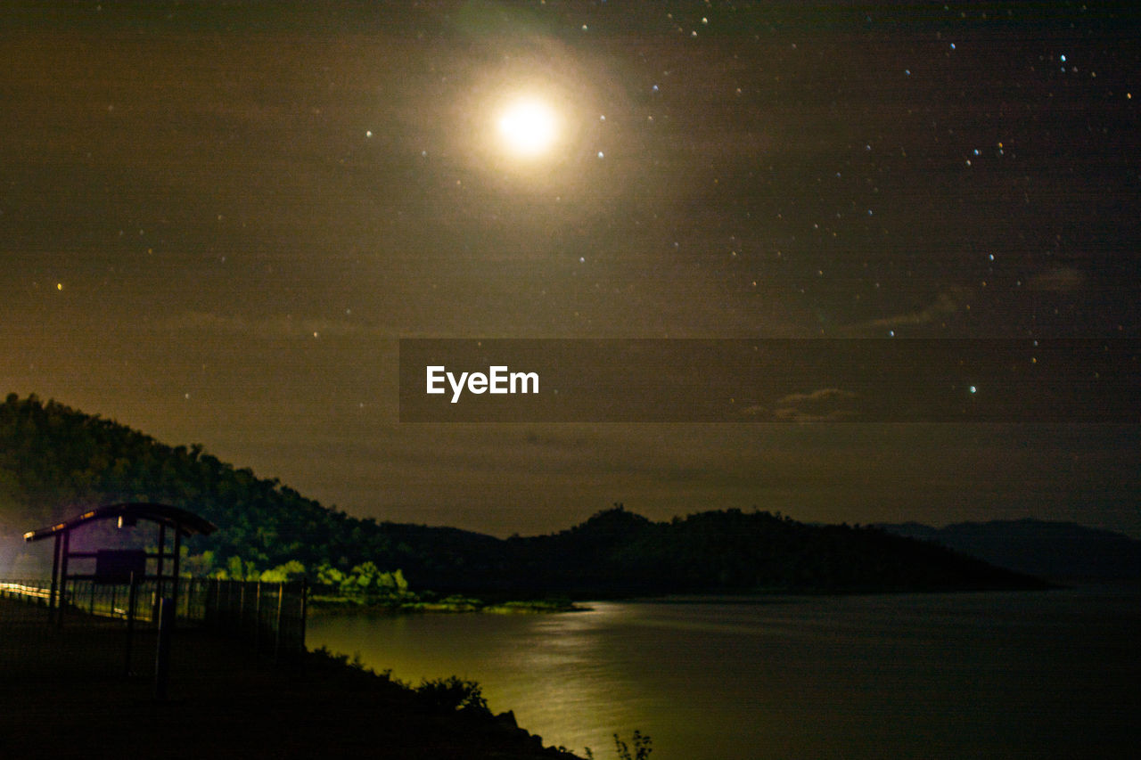 beauty in nature, scenics, nature, night, tranquil scene, tranquility, sky, lake, idyllic, water, mountain, moon, no people, star - space, outdoors, tree, silhouette, landscape, astronomy, galaxy