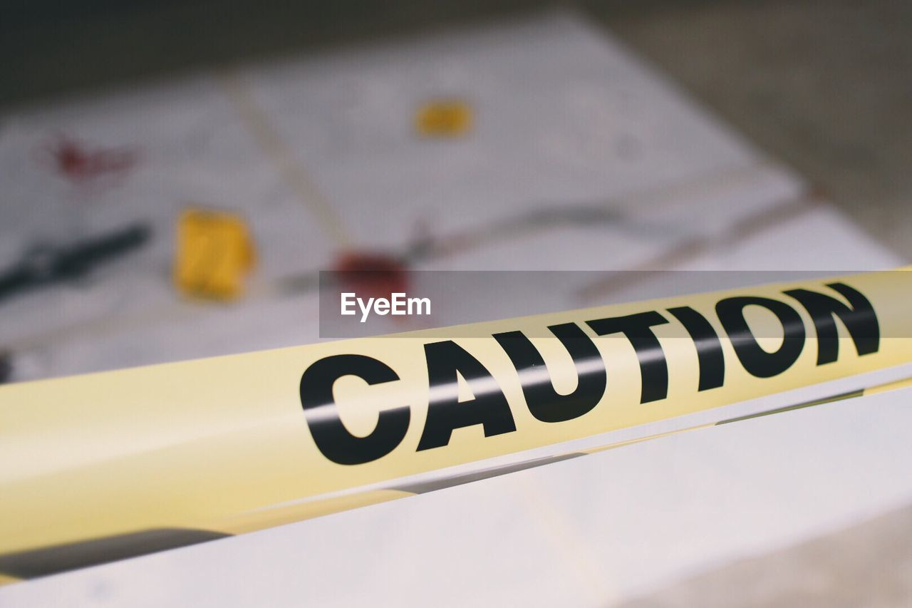 Close-up of caution text on paper