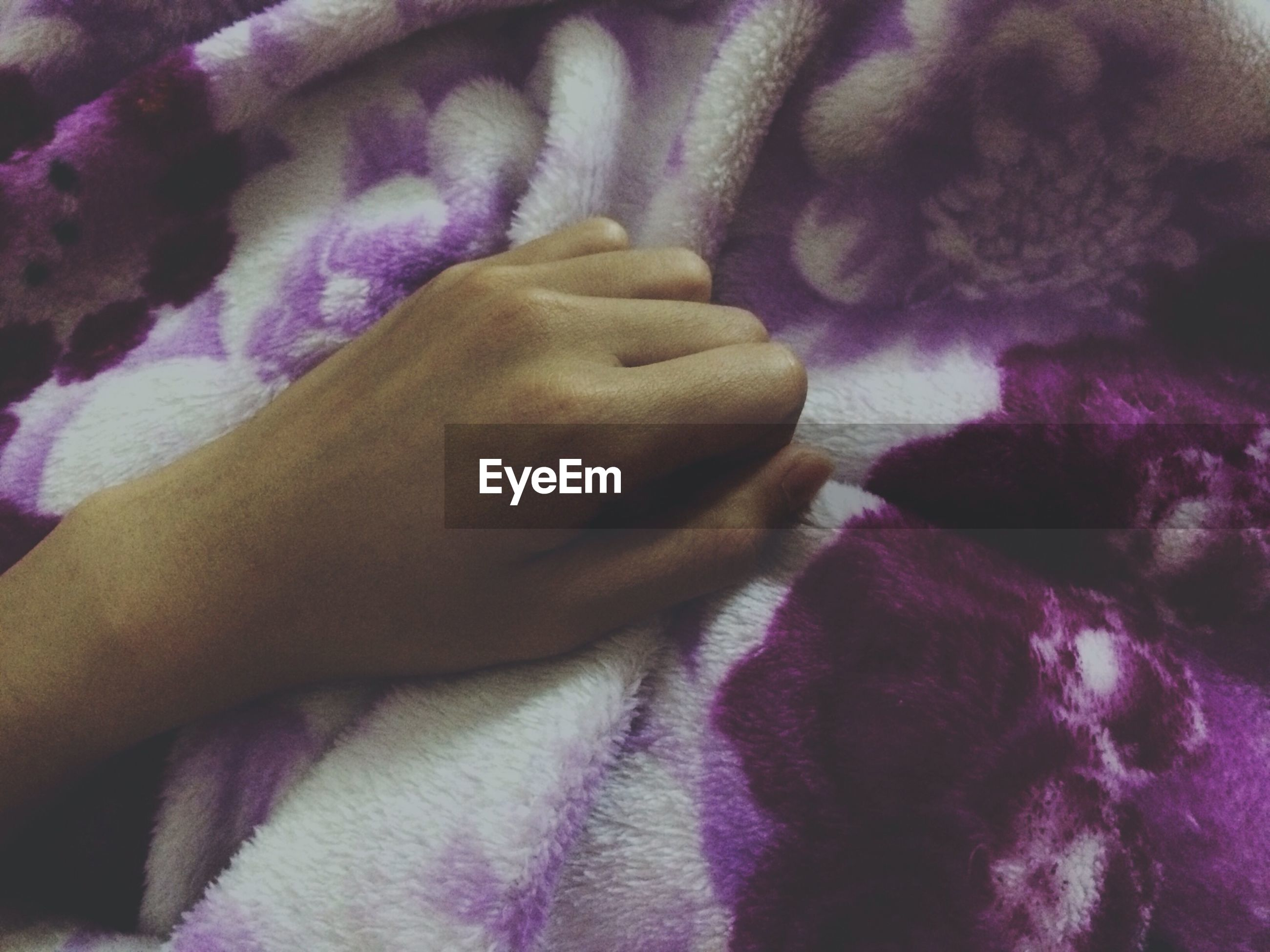 indoors, person, part of, lifestyles, cropped, bed, close-up, human finger, leisure activity, unrecognizable person, purple, men, midsection, holding, relaxation, textile