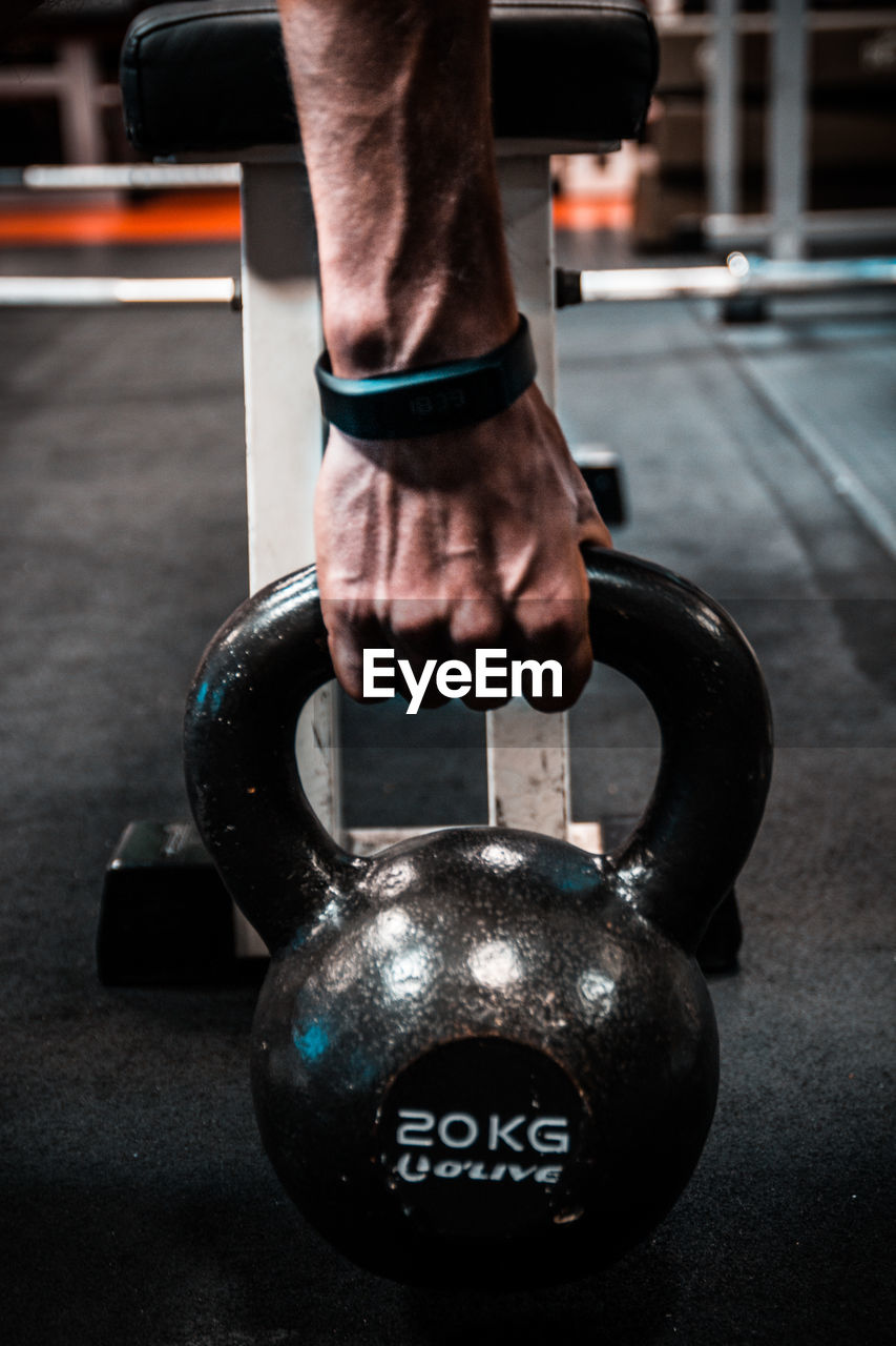 gym, human body part, lifestyles, strength, exercising, one person, real people, holding, focus on foreground, human hand, men, healthy lifestyle, sport, exercise equipment, indoors, health club, close-up, day, athlete, people