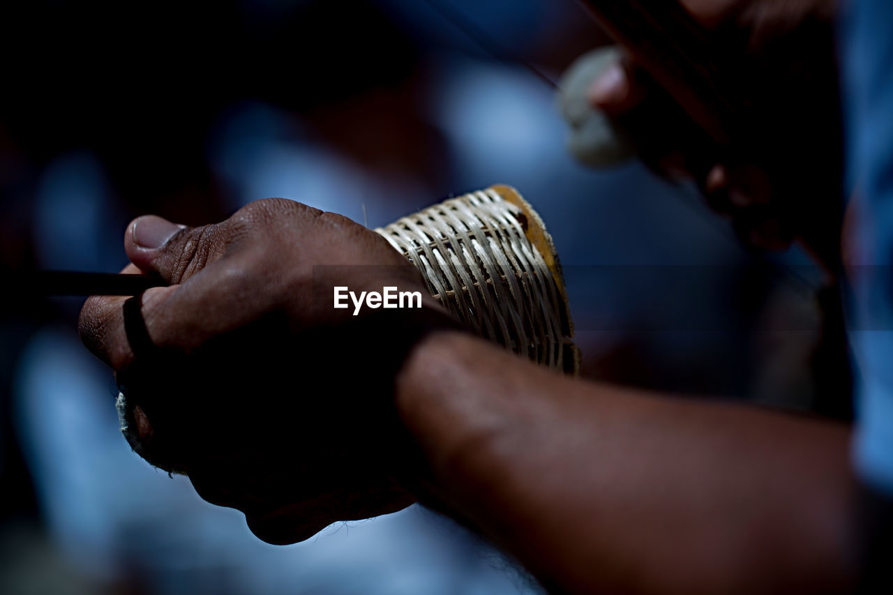 hand, human hand, holding, real people, indoors, selective focus, focus on foreground, one person, men, human body part, occupation, close-up, skill, business, metal, midsection, lifestyles, unrecognizable person, wood - material, human limb, finger